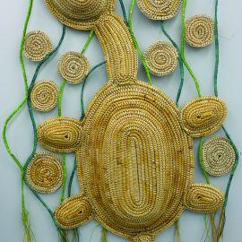 Donna Blackall (Yorta Yorta, Taungerong) The Family Crest (2016),  New Zealand flax, raffia, wood.   Koorie Heritage Trust Collection, AH 3956.  Image: Maia McDonald