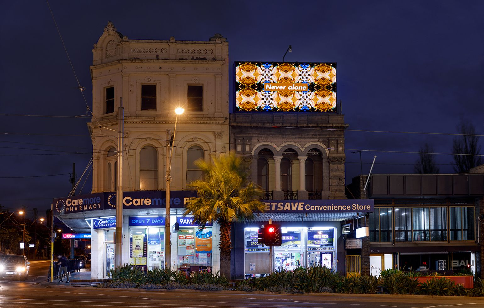 Kent Morris, Never alone 2020, digital billboard, installation image, intersection of Fitzroy Street, Canterbury Road and Grey Street, St Kilda, Melbourne. Commissioned by ACCA. Courtesy the artist. Photograph: Andrew Curtis