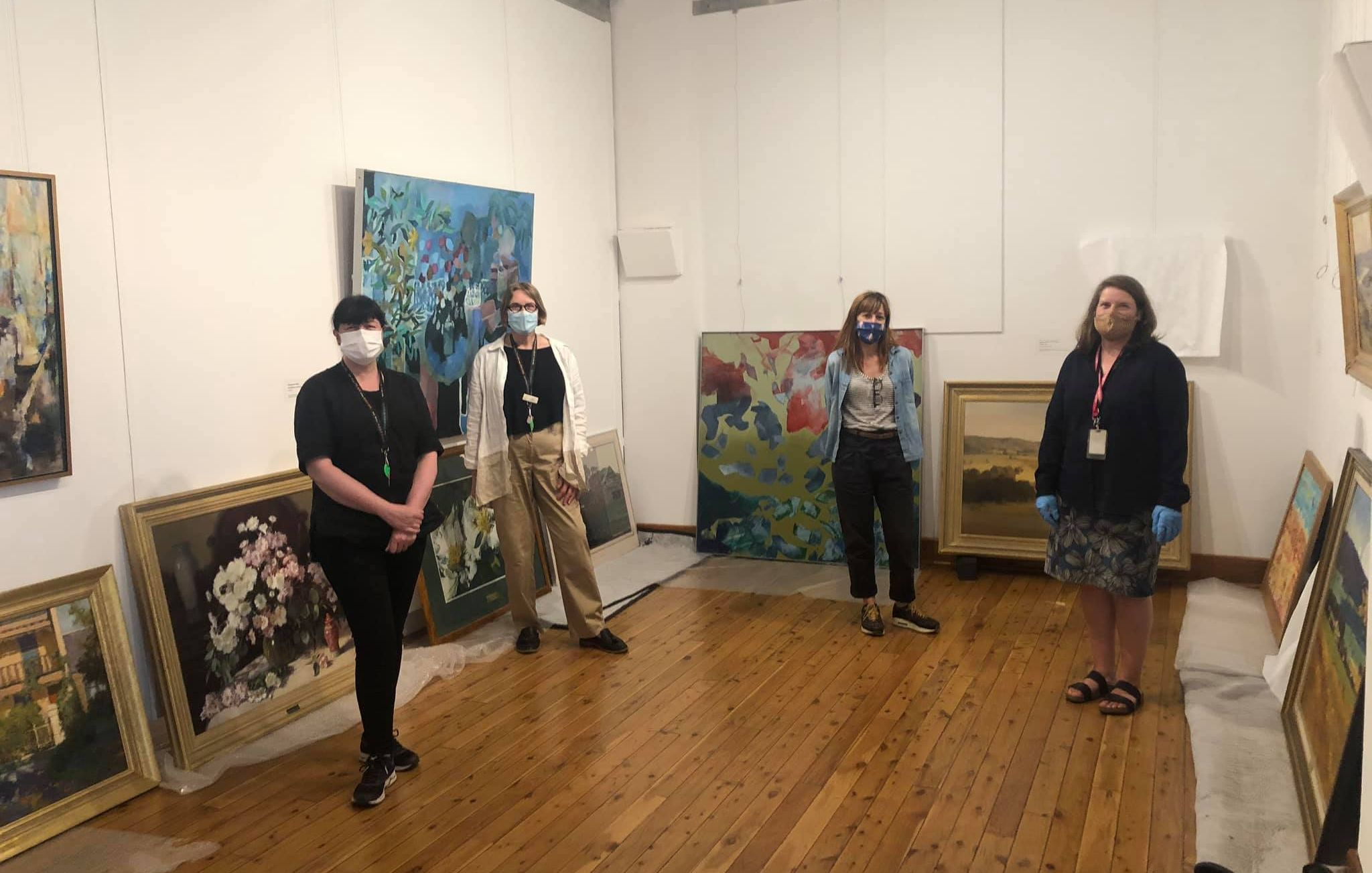 Staff at Wangaratta Art Gallery working to digitise the collection as part of Creative Victoria's Digital Roadshow