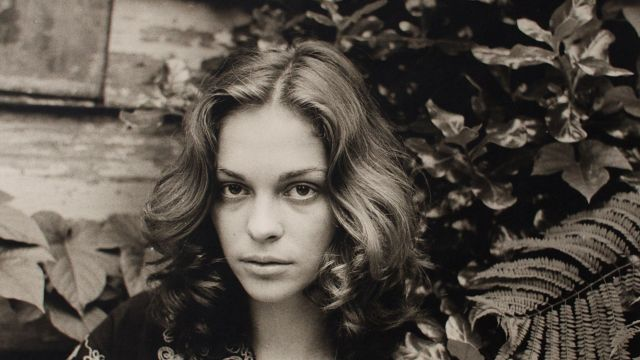 Carol JERREMS Juliet 'Girl amongst leaves'  1976 gelatin silver print 20.2 x 30.3 cm Monash Gallery of Art, City of Monash Collection acquired with assistance of the MGA Foundation 2012 courtesy of Ken Jerrems and the Estate of Lance Jerrems
