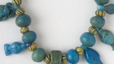 Egyptian necklace, 1550 BCE - 395 CE, faience, glass. The University of Melbourne Art Collection. Classics and Archaeology Collection. Gift of Miss D Kilburn. 1968.0062.