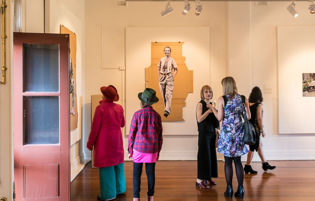 Visitors attend the opening of the exhibition 'Dapper' at Bundoora Homestead Art Centre on the 31st January 2019. 'Dapper' explores the clothes we wear, and how fashion can both define and expose us. The exhibition continues until 3 March.