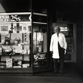 Viva Gibb, Mr Williams at his barber and tobacconist shop, Errol Street, North Melbourne, c. 1982. Courtesy of the Estate of Viva Gibb.