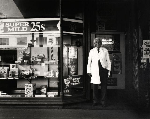 Viva Gibb, Mr Williams at his barber and tobacconist shop, Errol Street, North Melbourne, c. 1982. Courtesy of the Estate of Viva Gibb.