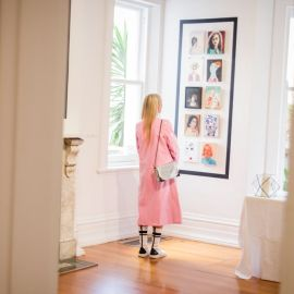 Visitor during the Linden Postcard Show 2018-19, [installation view]. Photograph: Theresa Harrison Photography.