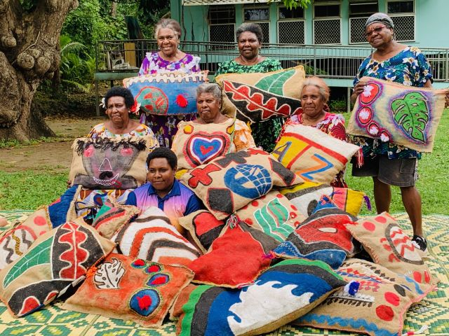 Marep Pamle artists (from top left) Kalina Day, Nellie Passi, Mary Kaigey, Helen Mabo, Helen Dick, Dulcie Anne Gibas, and Reteah Tapim Mas, cushions jute, fabric paint, corn fibre, thread Photography courtesy NGV © The artists
